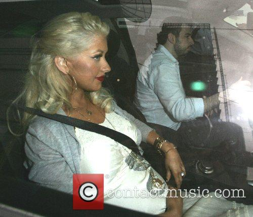Christina Aguilera and Jordan Bratman leaving from a...