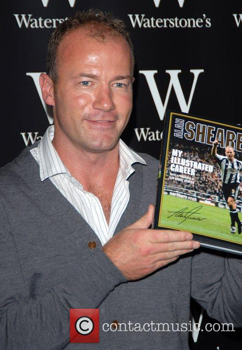 Signs copies of his autobiography 'My Illustrated Career'...