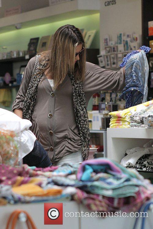 A pregnant Alessandra Ambrosio shops at Kitson Boutique...