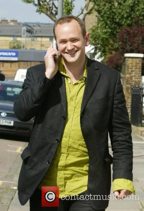 Alexander Armstrong talking on the phone through Notting...