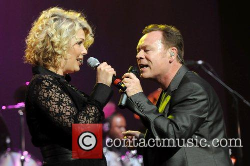 Kim Wilde and Ali Campbell performing live in...