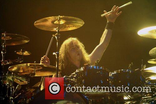 Eric Singer, drummer for Alice Cooper performing at...