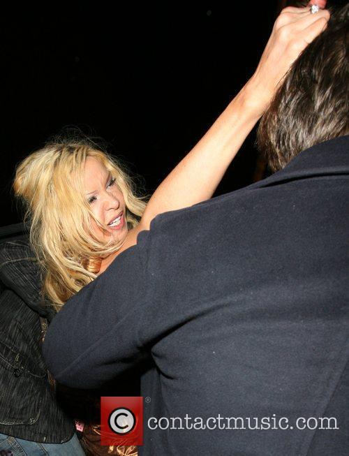 Alicia Douvall leaving Funky Buddah nightclub. As she...