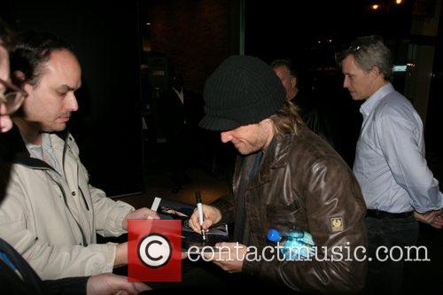 Keith Urban signs autographs as he arrives at...