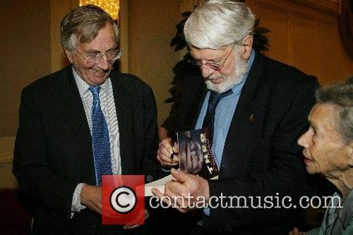 Theodore Bikel autographs his book 'Theo' for Seymour...