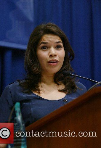 Accepts a Latina Leader award during the Congressional...