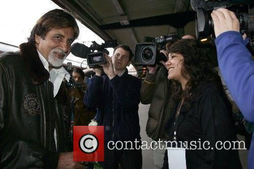 The Bollywood legend arrives at the train station...