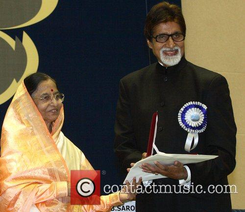 Presents Bollywood actor Amitabh Bachchan with the National...