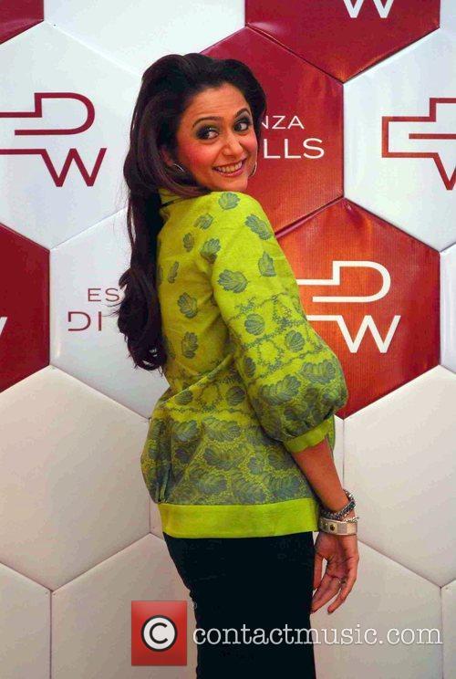 Bollywood actress Amrita Arora  poses for photographers...