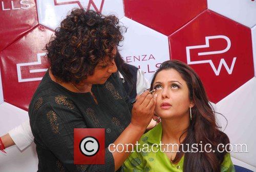 Bollywood actress Amrita Arora  has her make...