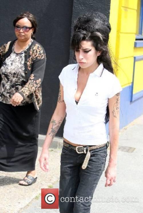 Amy Winehouse takes a stroll through Camden London,...
