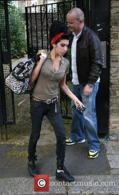 Amy Winehouse leaving her house in a taxi...
