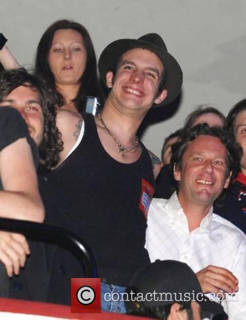 Amy Winehouse's husband Blake Fielder-Civil watches her show...
