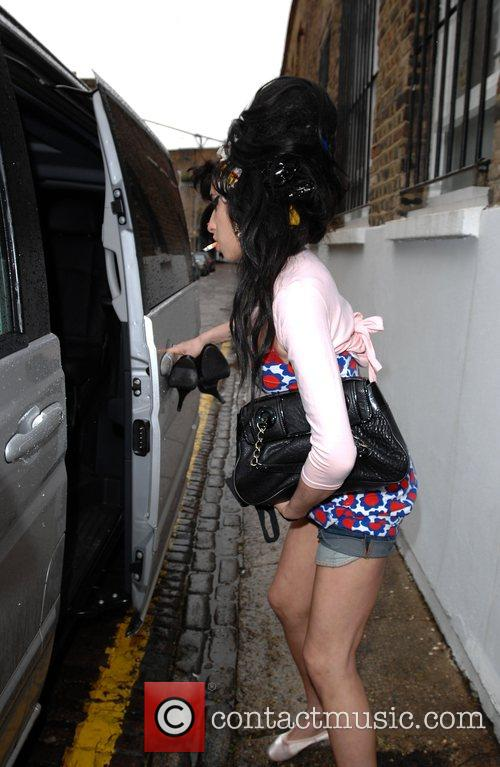 Amy Winehouse gets into the car taking her...