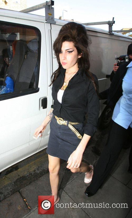 Amy Winehouse makes a stop at a some...