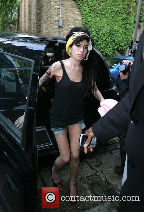 Amy Winehouse arrives home after visiting husband Blake...