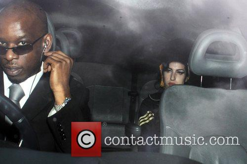Amy Winehouse leaving her home to visit her...