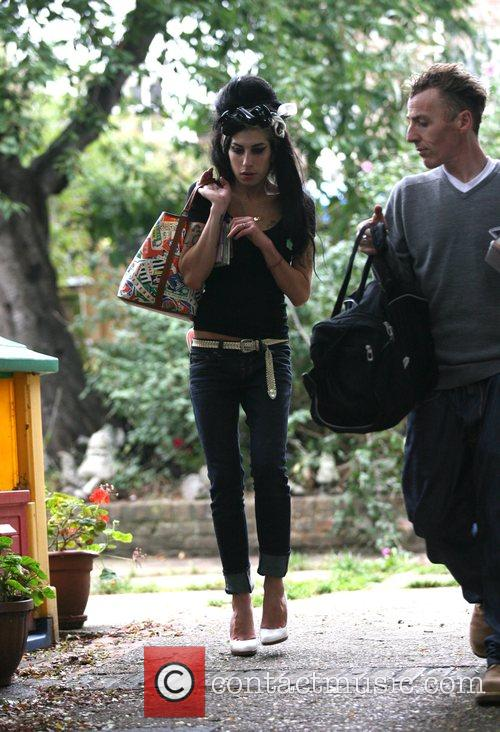 Amy Winehouse leaves her North London home, making...