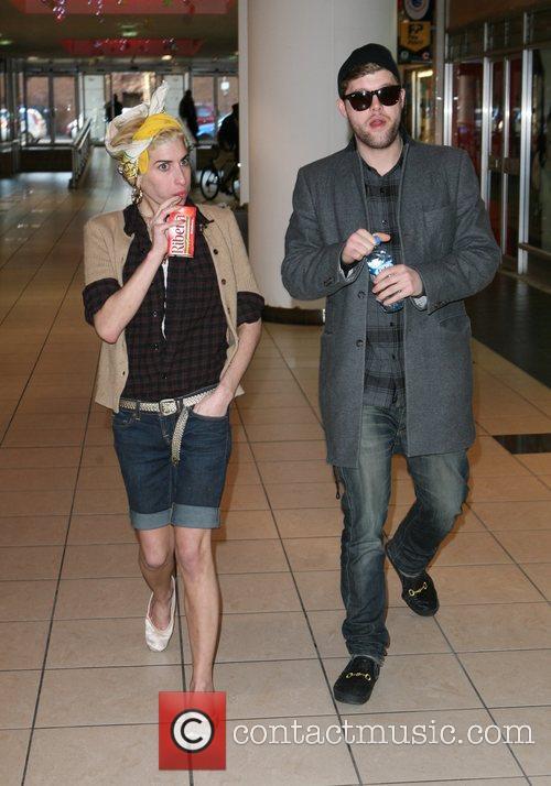 Amy Winehouse and singer friend Daniel Merriweather indulge...