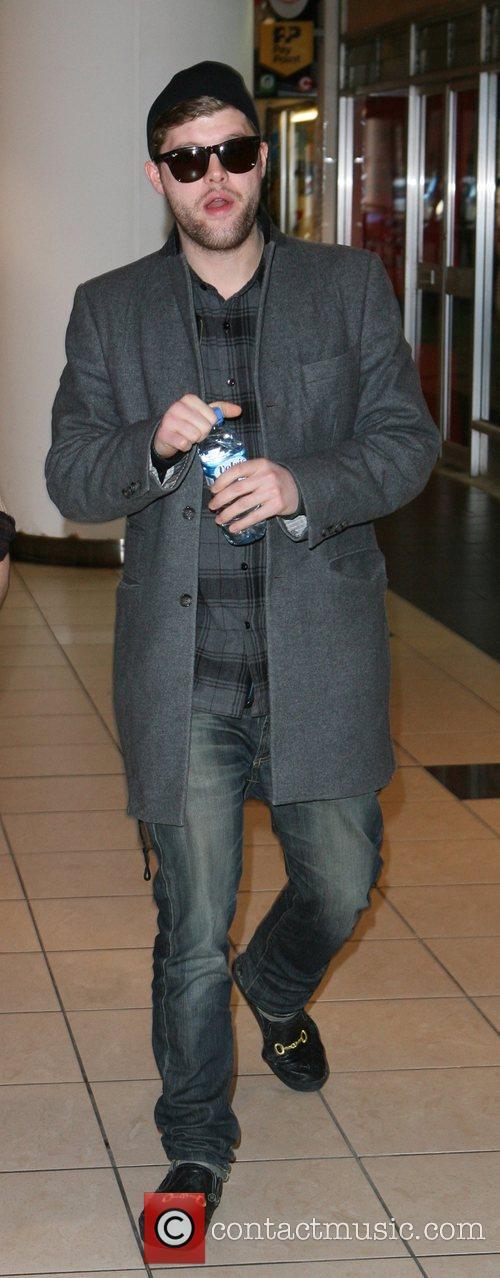 Singer Daniel Merriweather out shopping London, England
