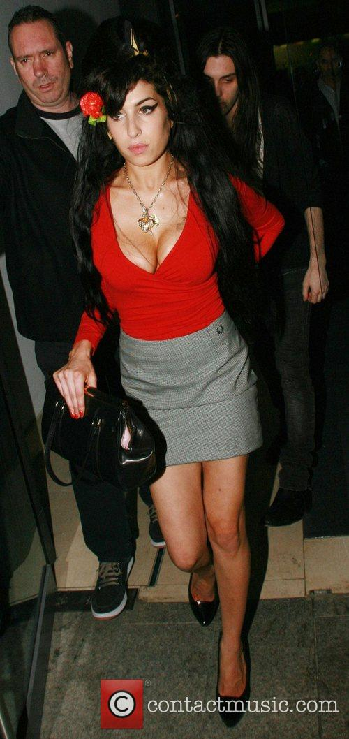 Amy Winehouse leaving her hotel with friend Blake...