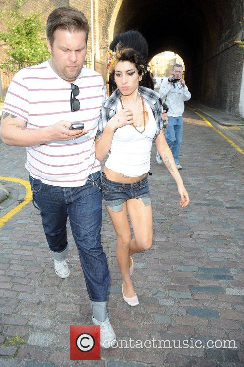Amy Winehouse spotted with a mystery man visiting...