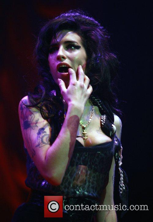 WINEHOUSE DEDICATES GIG TO JAILED HUSBAND Troubled star...