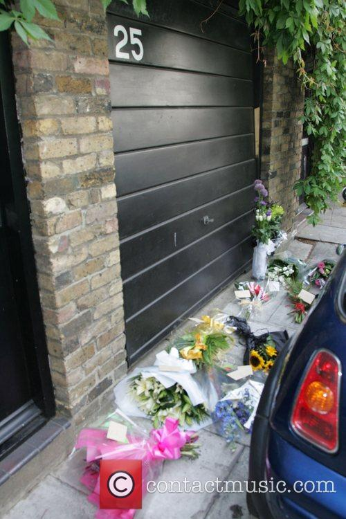 Amy Winehouse receives flowers on her one year...