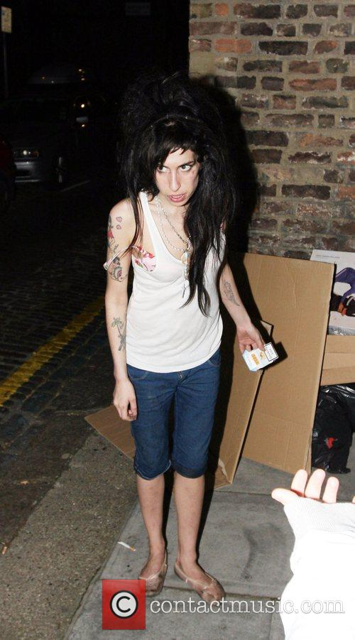 Amy Winehouse returns home after a night out...