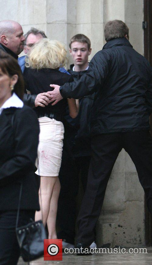 Amy Winehouse makes her way to court where...
