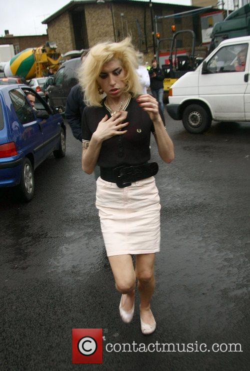 Amy Winehouse leaving McDonald's before she makes her...