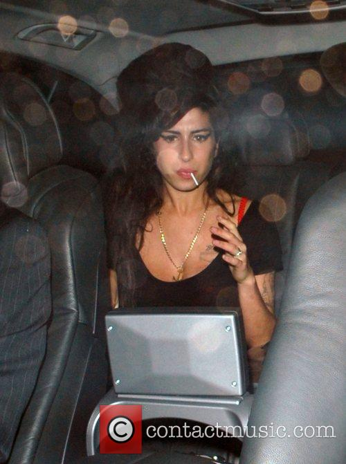 Amy Winehouse arriving to perform live at the...