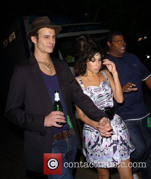 Amy Winehouse and Blake Fielder-Civil leave after performing...
