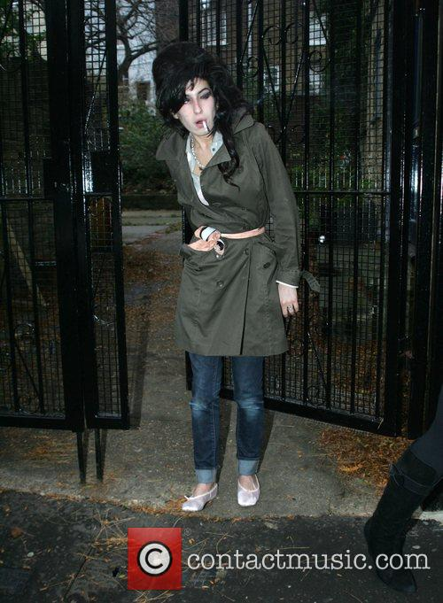 Amy Winehouse leaves her home on the way...