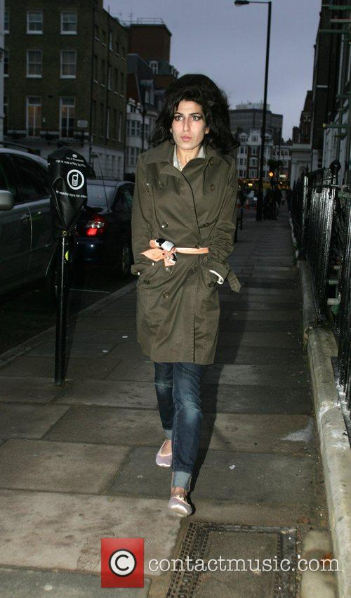 Amy Winehouse waiting outside the London Clinic for...