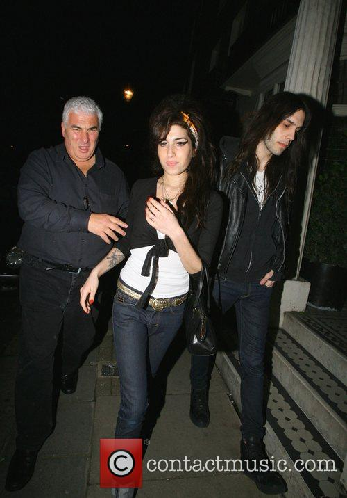 Amy Winehouse with Mitch Winehouse leaving the Capio...