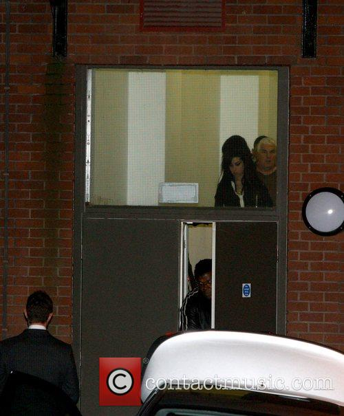 Amy Winehouse and her father Mitch Winehouse leaving...