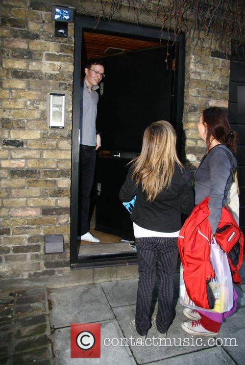 Fans of Amy Winehouse approach the singer's home...