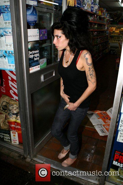 Amy Winehouse heads to her local newsagent to...