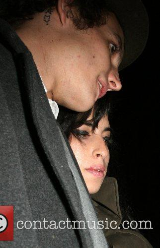 Amy Winehouse and Blake Fielder-Civil leaving Century Club...