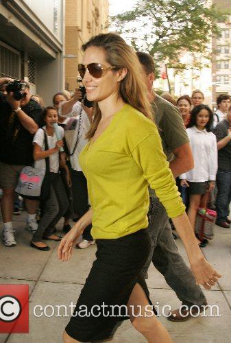 Picks up Maddox Jolie-Pitt from Lycee Francais School