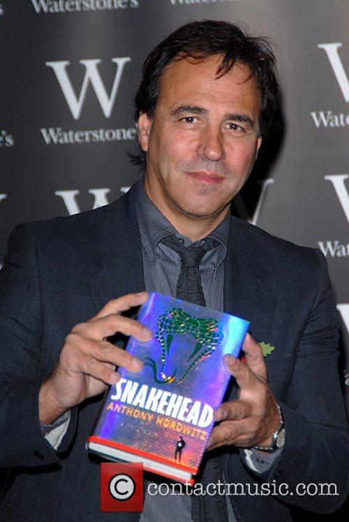 Signs copies of his new book 'Snakehead' at...