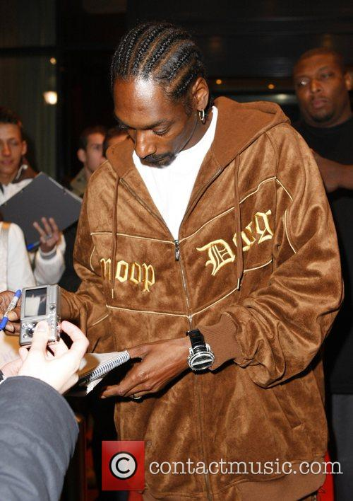 Snoop Dogg leaving the Arabella Sheraton hotel and...