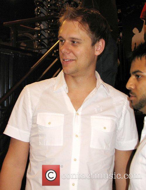 Number one DJ, Armin Van Buuren signs copies...