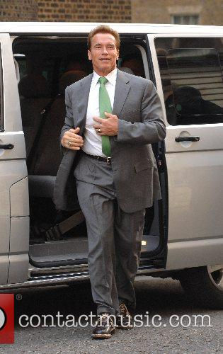 California's Governor Arnold Schwarzenegger arrives at 10 Downing...