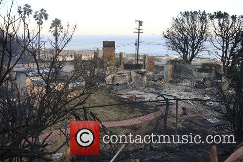 The Corral Canyon wildfire in Malibu continues to...