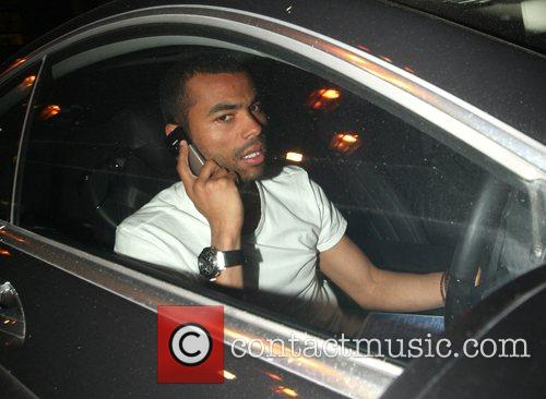 Ashley Cole speeds off in his car from...