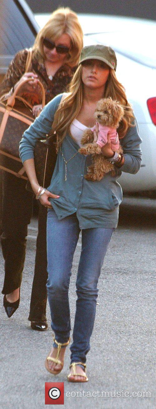 High School Musical's Ashley Tisdale carrying her dog...
