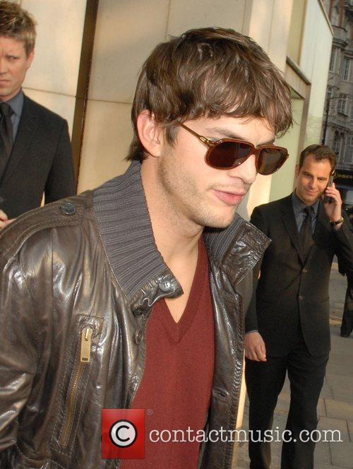 Ashton Kutcher leaving his hotel to attend the...