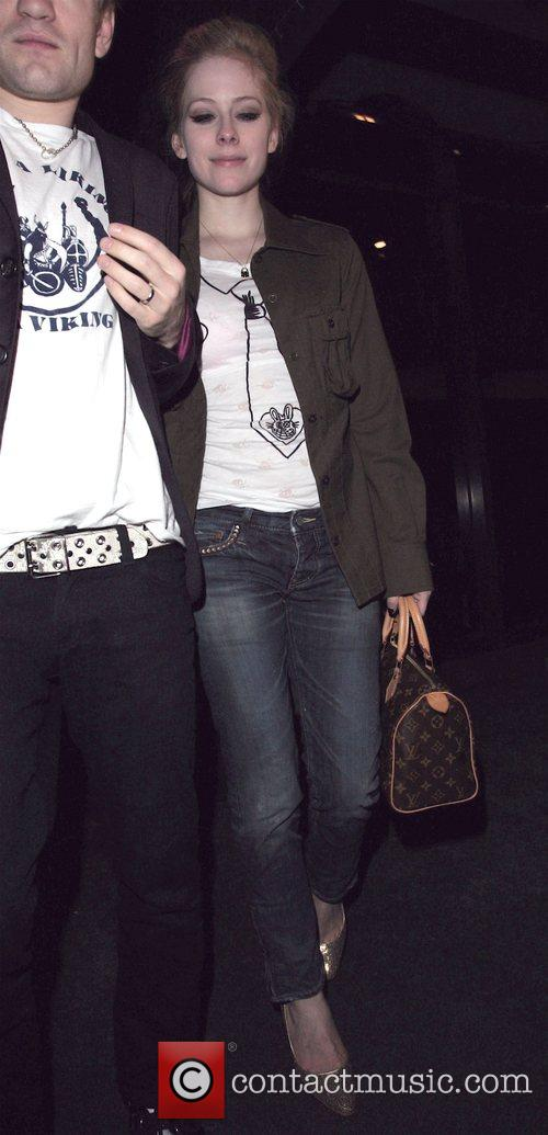 Avril Lavigne leaving Madeo restaurant with her husband...